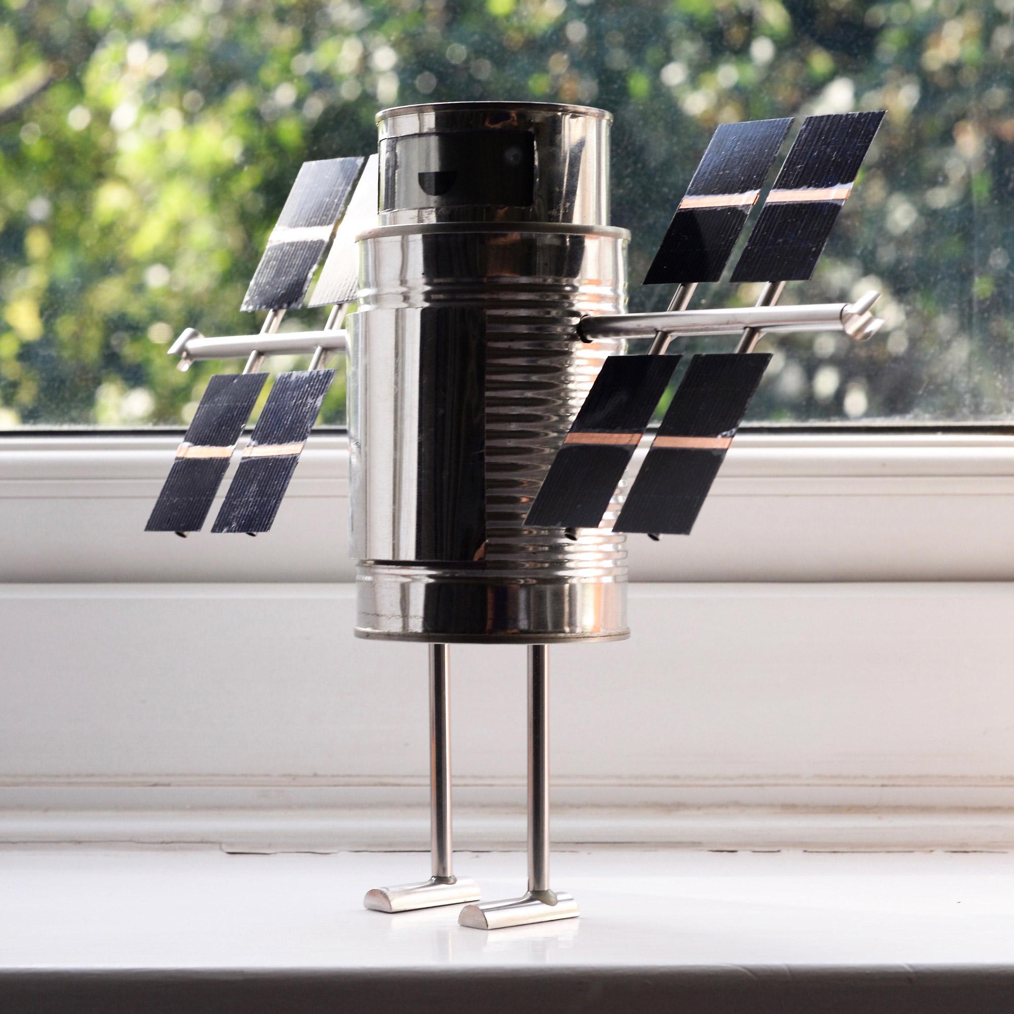 My solar robot, sitting on the windowsill, harvesting sunlite